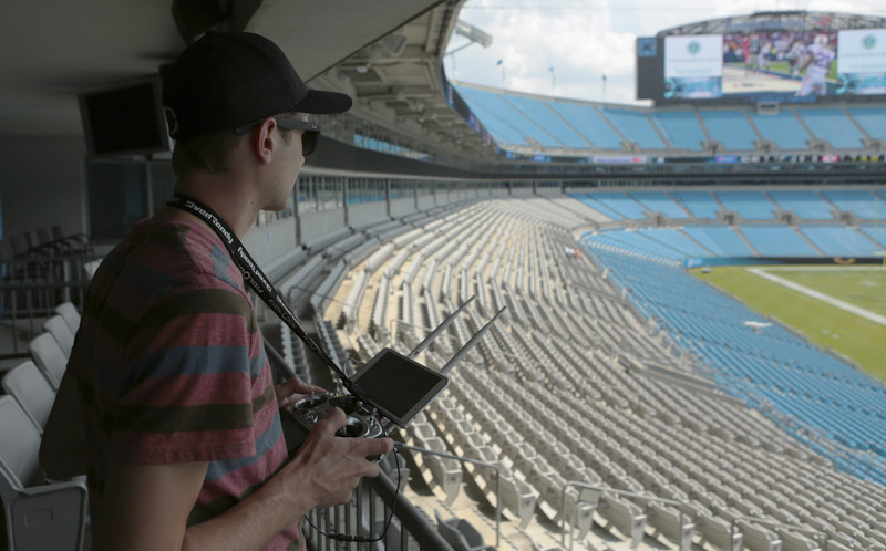 nowsay zach flying drone in carolina panthers stadium