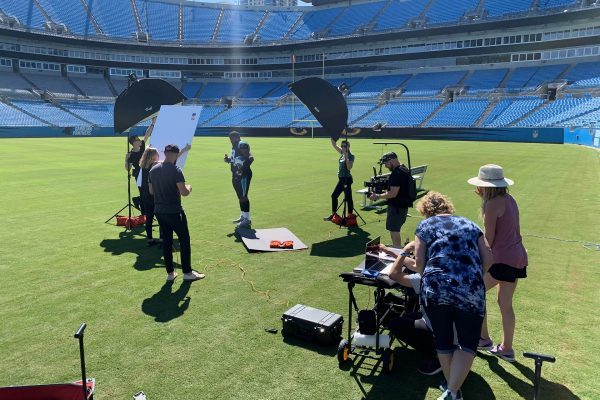 wide shot panthers and coca cola photo shoot behind the scenes
