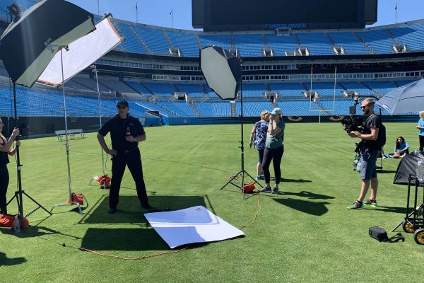 zach filming coach ron rivera of the carolina panthers